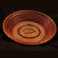 A private collection pine needle basket made by Ivy Howard.