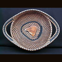 A pine needle basket made and sold by Ivy Howard.